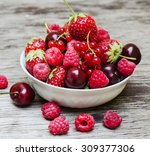 delicious ripe berries on a...   Shutterstock . vector #309377306