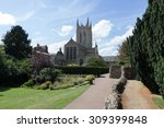 Small photo of St Edmundsbury Cathedral with gardens and path in foreground
