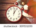 huge clock and santas hat with...