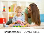 mother with his child play... | Shutterstock . vector #309617318