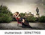 beautiful blonde woman sitting... | Shutterstock . vector #309677903