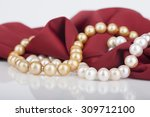 pearls necklace on satin... | Shutterstock . vector #309712100