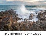 Sea Wave Splashing Over Rocks