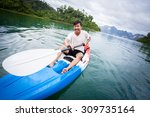 young boy so happy paddling... | Shutterstock . vector #309735164