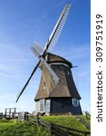 a traditional dutch windmill... | Shutterstock . vector #309751919