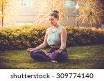 yoga meditation in lotus pose... | Shutterstock . vector #309774140