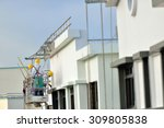 workers painting the exterior... | Shutterstock . vector #309805838