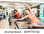 young women exercising on... | Shutterstock . vector #309970736