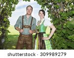 couple in traditional bavarian... | Shutterstock . vector #309989279