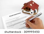 signing real estate contract  ... | Shutterstock . vector #309995450