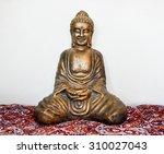 statue of sitting golden buddha | Shutterstock . vector #310027043