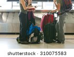 suitcase on luggage conveyor... | Shutterstock . vector #310075583