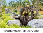 Watermill In Beautiful Garden