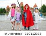 Four Kids Dressed In Princesse...