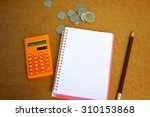 financial concept with Notebook, eyeglass and calculator on wooden background  - stock photo