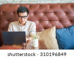 young asian man drinking coffee ... | Shutterstock . vector #310196849