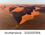 aerial view of high red dunes ... | Shutterstock . vector #310205396