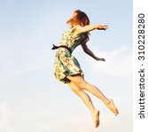 happy young woman jumping | Shutterstock . vector #310228280