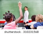 happy schoolchildren at primary ... | Shutterstock . vector #310231568