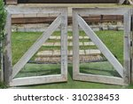 Wooden Fence And Gate Open To...