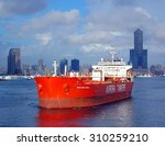 Small photo of KAOHSIUNG, TAIWAN -- AUGUST 12, 2015: The Hong Kong registered oil tanker Maritime Gisela makes its way towards the Kaohsiung Port exit.