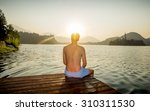 man sitting on wooden pier in... | Shutterstock . vector #310311530
