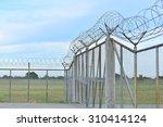 barbed wire steel mesh walls of ... | Shutterstock . vector #310414124