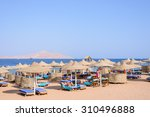 thatched beach umbrellas and... | Shutterstock . vector #310496888
