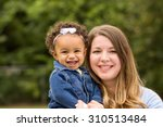 mother and daughter | Shutterstock . vector #310513484