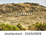 luderitz city sign in the... | Shutterstock . vector #310565858