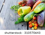 vegetables on a wooden... | Shutterstock . vector #310570643
