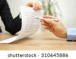 businesswoman holding legal... | Shutterstock . vector #310645886