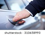 hands on car door | Shutterstock . vector #310658993