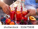 picnic on the beach at sunset... | Shutterstock . vector #310675838