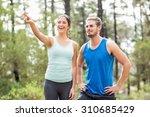 happy joggers looking away... | Shutterstock . vector #310685429