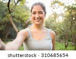 smiling athletic brunette...   Shutterstock . vector #310685654