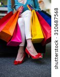 woman holding many shopping