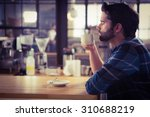 worried man drinking a coffee... | Shutterstock . vector #310688219