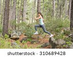 young happy jogger jumping from ... | Shutterstock . vector #310689428