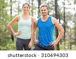 happy joggers looking at camera ... | Shutterstock . vector #310694303
