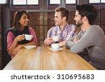 group of friends enjoying a... | Shutterstock . vector #310695683