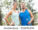 happy joggers looking away in... | Shutterstock . vector #310696250