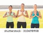 smiling sporty women doing yoga ... | Shutterstock . vector #310698908
