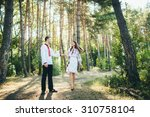 beautiful young couple in love... | Shutterstock . vector #310758104