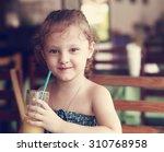 happy smiling kid girl drinking ... | Shutterstock . vector #310768958