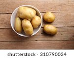 top view potatoes in bowl with... | Shutterstock . vector #310790024