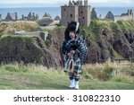 traditional scottish bagpiper... | Shutterstock . vector #310822310