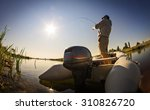 man fishing on a lake  | Shutterstock . vector #310826720