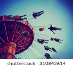 a swinging fair ride at dusk... | Shutterstock . vector #310842614