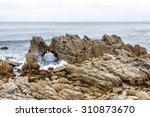waves splashing on huge rocks ...